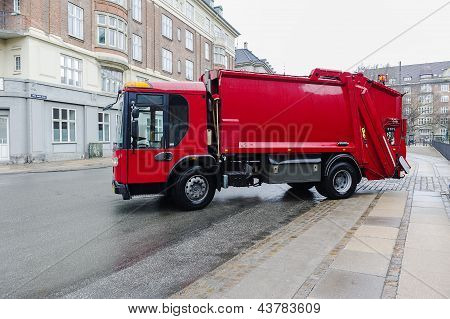 Red Garbage Disposal Truck