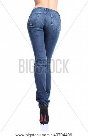 Back View Of A Long Woman Legs Posing With Jeans