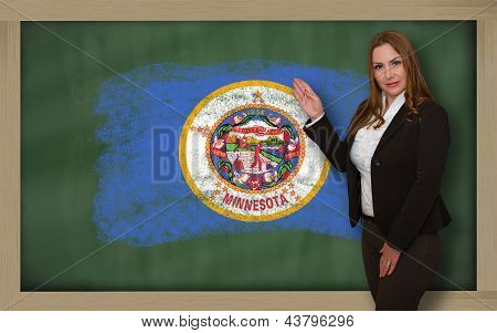 Teacher Showing Flag Of Minnesota On Blackboard For Presentation Marketing And Tourist Advertising