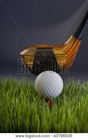 Golf ball and wood club.