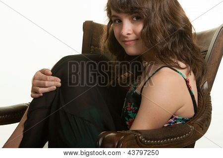 Young girl in armchair