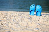 Blue Sandals On The Beach