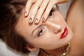 picture of minx  - Portrait of attractive girl with beautiful metallic spiral pattern Minx nails - JPG
