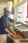 Chef Cooking In The Restaurant Kitchen Smiling poster