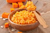 stock photo of porridge  - tasty porridge pumpkin puree and rice with milk - JPG