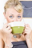 Attractive Blonde Woman Drinking Green Tea
