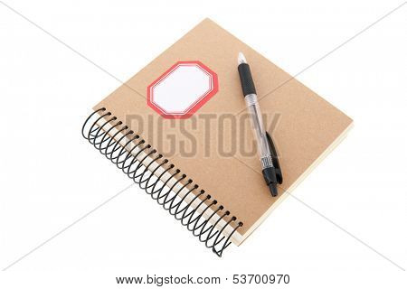 paper notebook with pencil isolated over white background