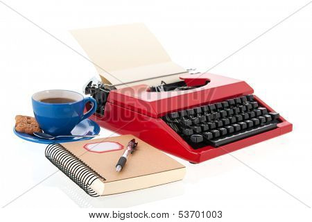 Vintage red typewriter with blank paper isolated over white background