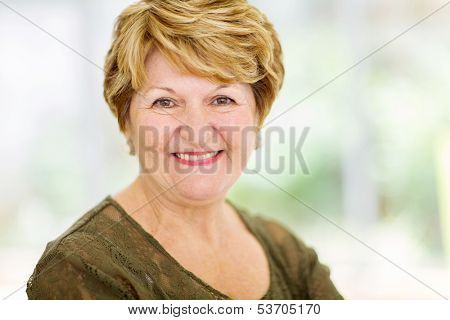 cheerful senior woman closeup portrait at home