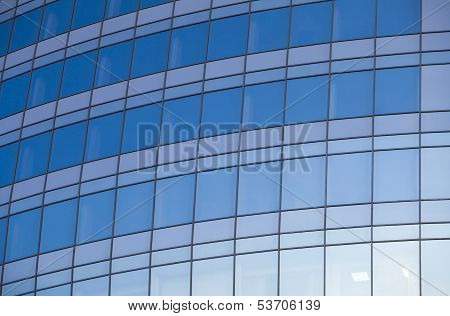 Reflexted Windows Of Rounded Office Tower