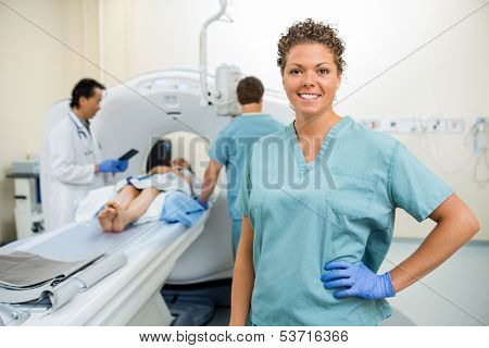 Portrait of nurse with colleague and doctor preparing patient for CT scan in hospital