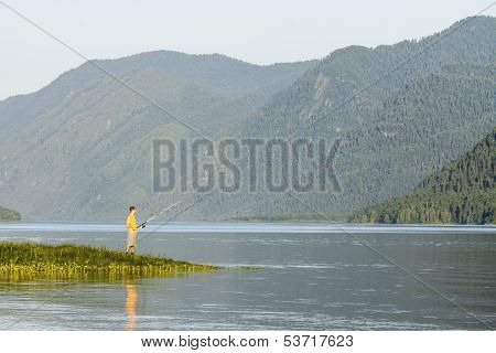 The Lake Is High In Mountains In The Summer Afternoon
