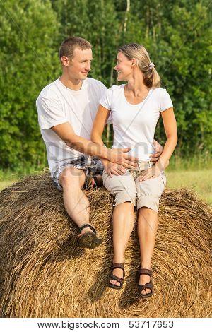 Happy Couple On Haystack