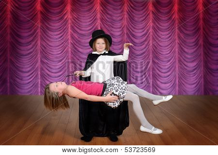 magician levitating assistant