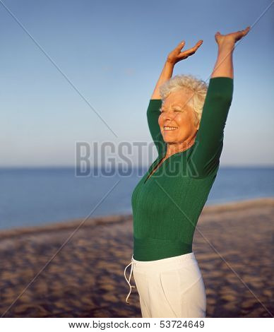 Old Caucasian Woman Exercising Outdoors To Stay Fit