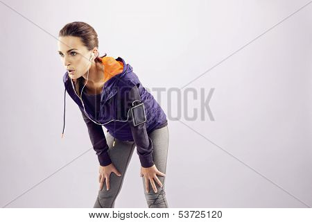 Tired Young Woman Resting After Jogging
