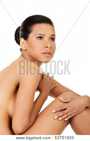 Attractive naked woman.  Bodypart. Closeup. Isolated on white.