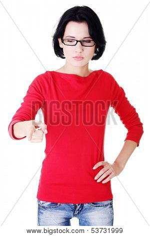 Attractive woman pointing down with eyeglasses. Isolated on white.