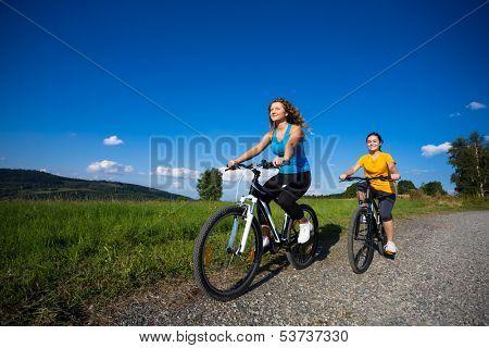 Two young women biking