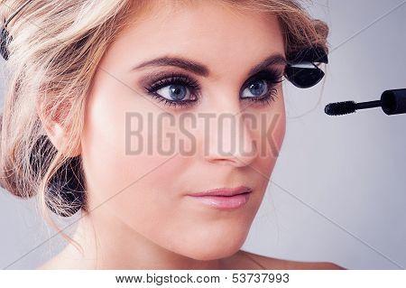 Closeup Of Girl Applying Eye Makeup.