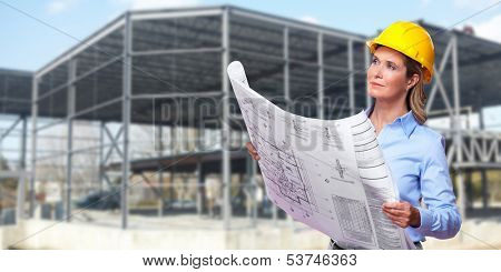 Professional Woman architect over Construction industry background.