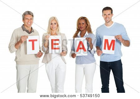 Happy Group Of People Holding Team Sign Board