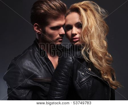 closeup picture of an embraced sexy couple on gray background