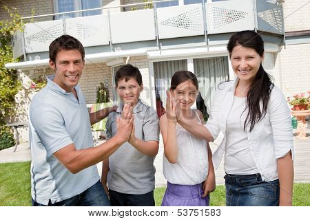 Excited Family Celebrating Buying New House