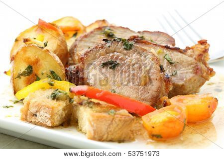 roasted pork with potatoes isolated on white (top)
