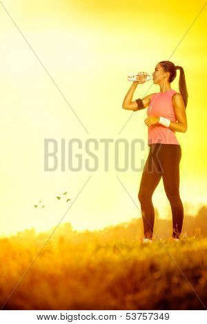 young thirsty sporty woman on sunny day