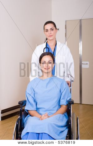 Doctor Pushing Patient On Wheelchair