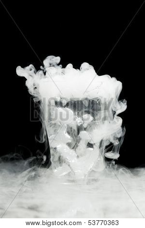 glass of water with ice vapor