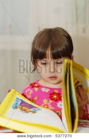 Child Reading The Book