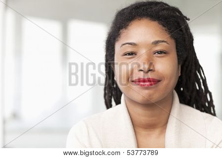 Portrait of smiling businesswoman with dreadlocks
