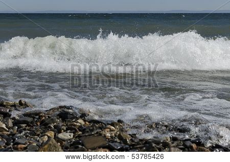 Wave with whitecaps on Lake Baikal in the windy weather