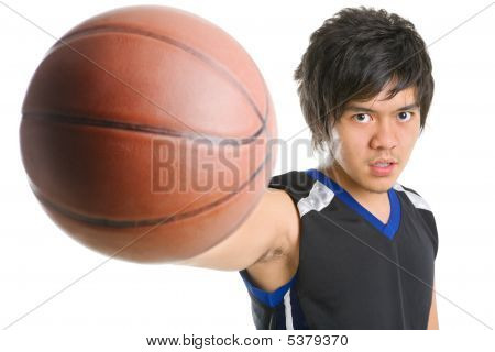 Basketball player holding his ball