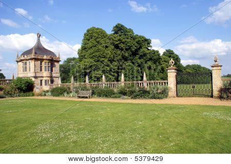 Decorative Summerhouse, Gate, Wall,& Bench In Garden