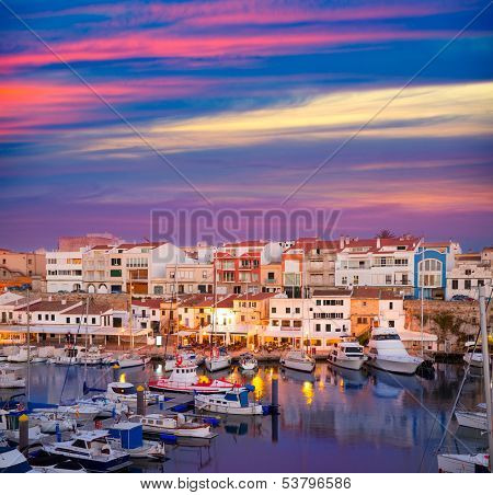 Ciutadella Menorca marina Port sunset with boats and streetlights in Balearic islands