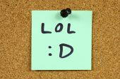 pic of lol  - Green small sticky note on an office cork bulletin board - JPG