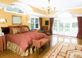 stock photo of armoire  - luxurious master bedroom with king size bed and beautiful window light - JPG