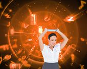 Composite image of angry businesswoman throwing her tablet pc while posing