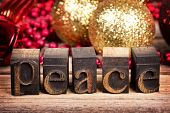 The word PEACE written with vintage wood printer blocks. Christmas message over old wood with tradit