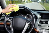 stock photo of designated driver  - Hand with microfiber cloth cleaning car - JPG