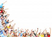 stock photo of joy  - Happy people group dancing with hands up - JPG