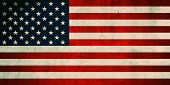 Grunge USA Flag. Background of national flag of United States of America printed on concrete wall, t