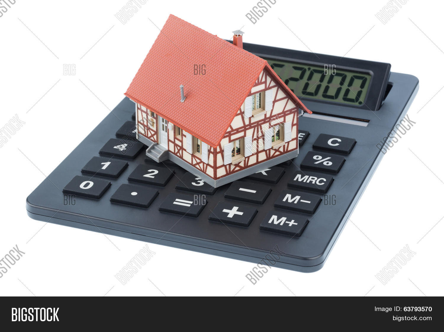 Residential Building On A Calculator Symbolic Photo For
