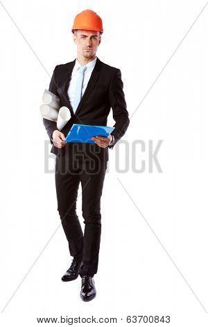 Portrait of a handsome businessman in helmet with blue folder over white background