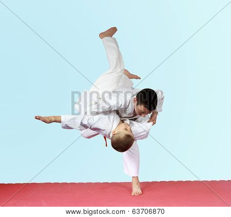 Throws judo two athletes are training on the mat