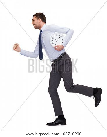 business, time and education concept - smiling young businessman with clock running
