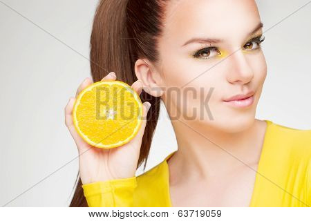 Girl with orange in her hand